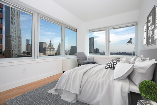 Interior gallery - 1 of 5 - bedroom with large windows and nice views from 200 Water St.