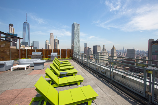 Amenities gallery - 2 of 8 - rooftop with views and lounge chairs at 200 Water St.