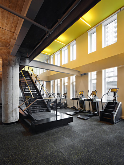 Amenities gallery - 4 of 7 - Gym featuring stair-masters and large double windows at Eagle Lofts