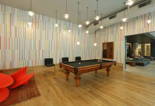 Amenities gallery - 5 of 7 - Game room with pool table at Eagle Lofts