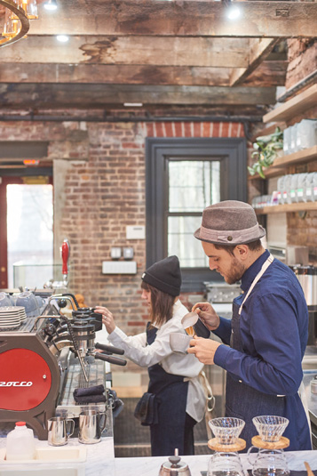 Neighborhood gallery - 8 of 8 - Male and female baristas making coffee