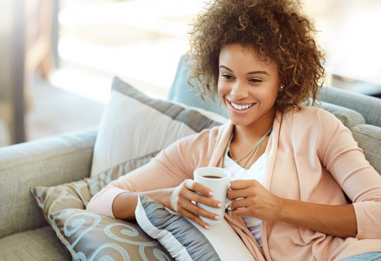 Interior gallery - 10 of 10 - Shot of a young woman relaxing with a warm beverage at home