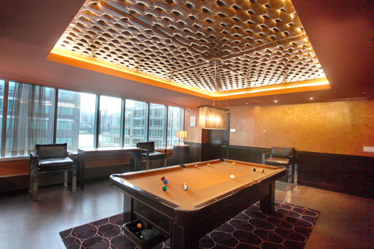 Amenities gallery - 1 of 6 - pool table in large room at 4705 Center Boulevard