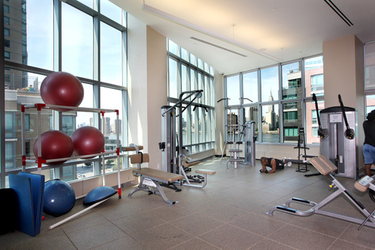 Amenities gallery - 2 of 6 - gym with free weights at 4705 Center Boulevard