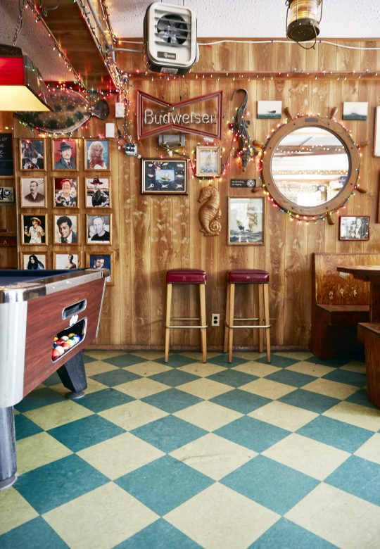 Neighborhood gallery - 1 of 7 - Bar interior with stools and wall decor