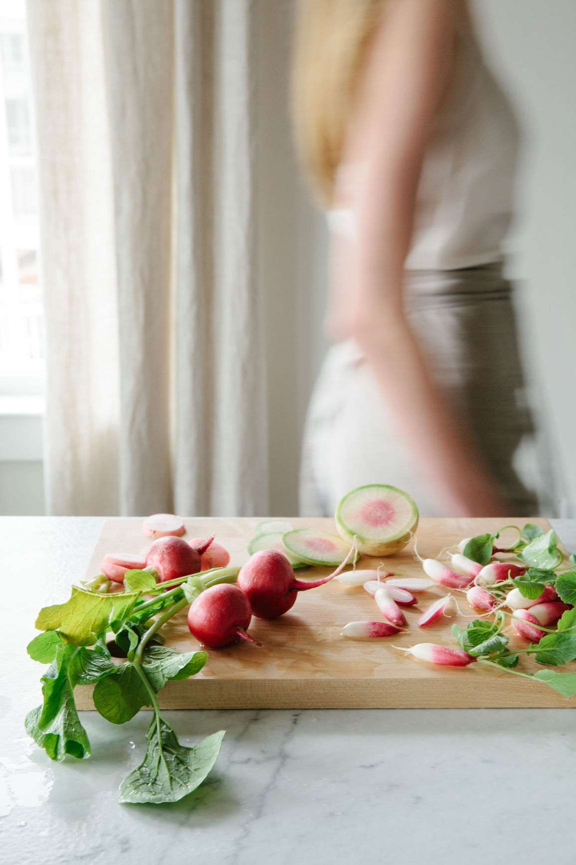 Interior gallery - 6 of 6 - Radishes on top of wood cutting board
